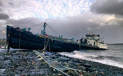 A 168-foot water tanker, the John B. Caddell, sits on the shore Tuesday morning, Oct. 30, 2012 where it ran aground on Front Street in the Stapleton neighborhood of New York's Staten Island as a result of superstorm Sandy. (photo credit: Sean Sweeney/AP)