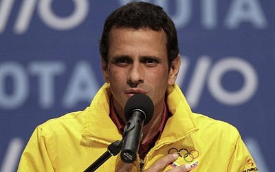 Opposition presidential candidate Henrique Capriles talks to supporters and media members as he concedes defeat in the presidential elections at his campaign headquarters in Caracas, Venezuela, Sunday, Oct. 7, 2012. Venezuela's electoral council said late Sunday President Hugo Chavez has won re-election, defeating challenger Capriles. (photo credit: AP Photo/Ariana Cubillos)