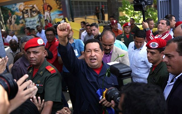 Venezuela's President Hugo Chavez arrives to a polling station during the presidential election in Caracas on Sunday. (photo credit: AP/Rodrigo Abd)
