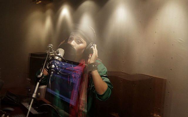 Afghanistan's first female rapper Sosan Firooz sings in a studio in Kabul, Afghanistan Oct. 3, 2012. (Photo credit: AP/Ahmad Jamshid)