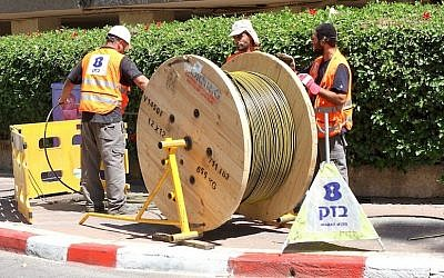 Bezeq workers installing fiber optic cables. (Courtesy)