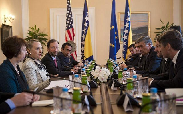 US Secretary of State Hillary Clinton (second left) and High Representative for EU Foreign Policy Catherine Ashton (left) meet with members of the Bosnia and Herzegovina Tri-Presidency, at the Presidency in Sarajevo, Bosnia on Tuesday. (photo credit: AP/Saul Loeb)