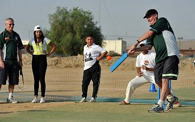 Spin bowler John Emburey shows off his cricket skills to Israeli and West Bank-Palestinian children in Beersheba (photo credit: David Katz/The Israel Project)