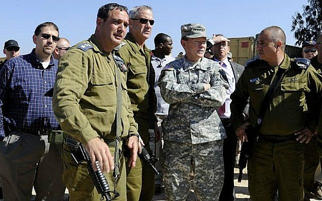 Martin Dempsey, second from right, and other officials at the Iron Dome battery site on Tuesday. (photo credit: Courtesy US Embassy Tel Aviv, via Twitter)