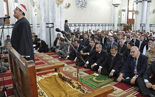 Egyptian President, Mohammed Morsi, front row second right, participates in Friday prayers in a mosque in Marsa Matruh, Egypt, Friday, Oct. 19 (photo credit: AP/Egyptian Presidency)