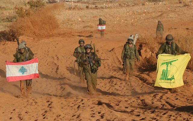 Israeli soldiers with Lebanon and Hezbollah flags returning from southern Lebanon on the last day of the 2006 war (Photo credit: Pierre Terdjman/ Flash 90)