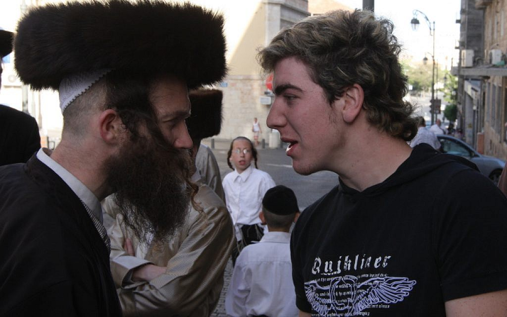 Ultra-Orthodox and secular Jewish men face off in Jerusalem, 2008. (Nati Shohat/Flash90)