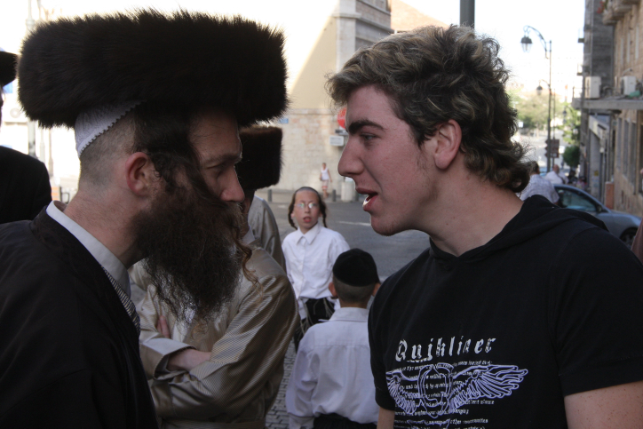 Ultra-Orthodox and secular Jewish men face off in Jerusalem, 2008. (photo credit: Nati Shohat/Flash90)