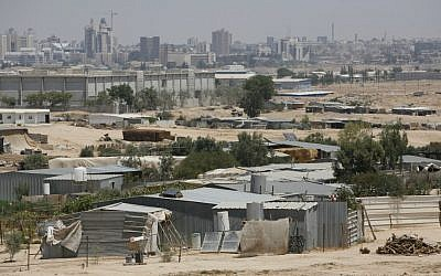 A view of the Bedouin town of Segev Shalom, with the city of Beersheba in the background (photo credit: Miriam Alster/Flash90)