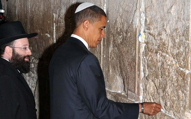 No, he's not a member of the tribe. Then-presidential candidate Barack Obama (he's the one on the right) visits the Western Wall in Jerusalem, in July 2008. (photo credit: Avi Hayon/Flash90)