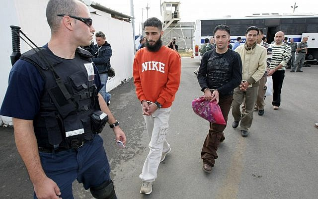 An Israeli prison guard escorts Palestinian prisoners before their release from the Ofer Prison near the West Bank town of Ramallah, December 15, 2008 (photo credit: Kobi Gideon/Flash90)
