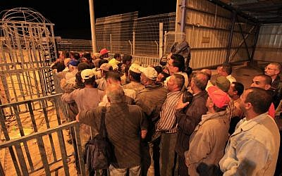 Palestinians line up before dawn to cross a checkpoint near Beersheba to attend work in Israel (Tsafrir Abayov/Flash90/File)