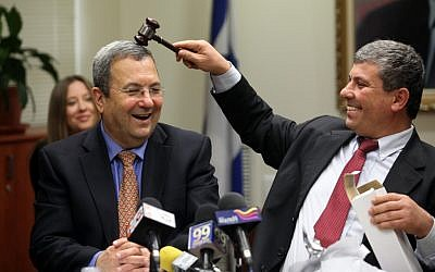 Defense Minister Ehud Barak, left, and Industry, Trade and Labor Minister Shalom Simhon, clowning together at a Knesset meeting in February 2010. (photo credit: Yossi Zamir/Flash90)