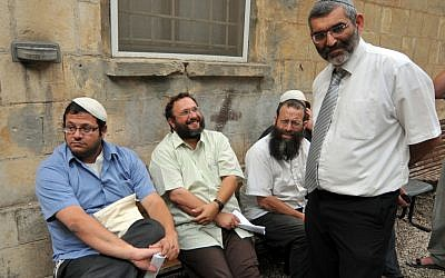 Itamar Ben-Gvir, left, with Baruch Marzel, seated on far right and Michael Ben-Ari, standing, with a fourth unidentified man outside a police station in Jerusalem in 2010. (photo credit: Flash90)