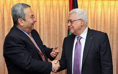 Defense Minister Ehud Barak (L) shakes hands with Palestinian President Mahmoud Abbas during a meeting in New York in 2010 (photo credit: Ariel Hermoni/Ministry of Defense/Flash90)