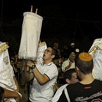 Israelis dance with Torah scrolls during the festival of Simchat Torah, September 2010. (Gershon Elinson/Flash90)