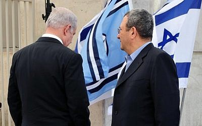 Prime Minister Benjamin Netanyahu and Defense Minister Ehud Barak seen at the arrival ceremony of captured Israeli soldier Gilad Shalit at the Tel Nof air force base, October 18, 2011. (Ariel Hermoni/Ministry of Defense/Flash90)