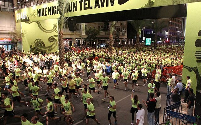 Runners at Rabin Square during the 2011 Nike Night Run (photo credit: Meir Partush/Flash90)