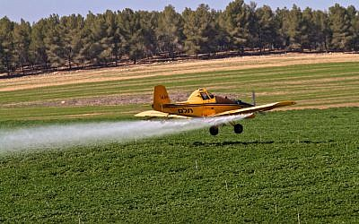 An agricultural aircraft sprays crops with fertilizers, pesticides, and fungicides. (Doron Horowitz/Flash90)