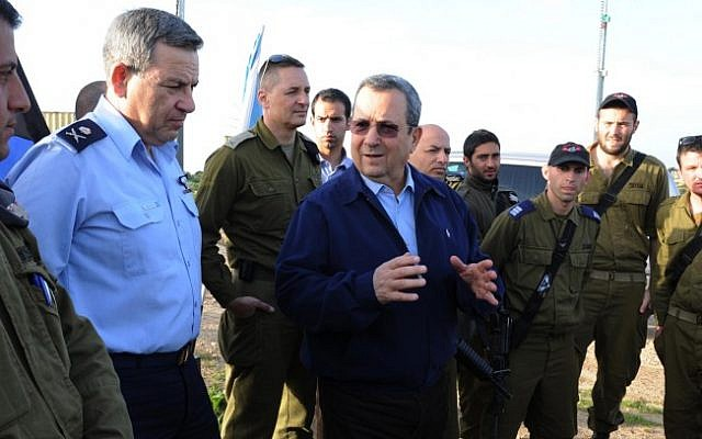 Defense Minister Ehud Barak visits an Iron Dome station in southern Israel in March. (photo credit: Ministry of Defense/Flash90)