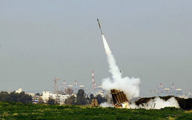 An Iron Dome interceptor rises toward a barrage of rockets over Ashdod in March 2012 (photo credit: Flash 90/ Maariv Out)