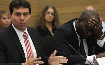 Danny Danon, left, attends a Knesset debate regarding the Sudanese refugees in Israel. To his right, the consul from Ivory Coast Consul seems exasperated. (photo credit: Miriam Alster/Flash90)
