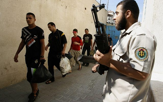 Palestinian prisoners wait to be released from prison in Gaza, July 2012. (Abed Rahim Khatib / Flash 90)