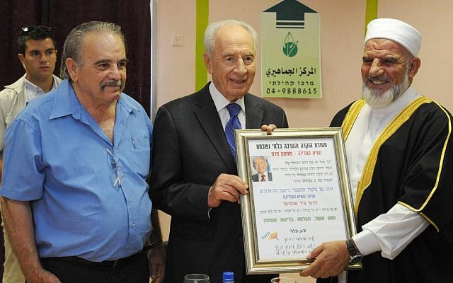 President Shimon Peres with the head of the Arab community in Majd al-Krum on August 21, 2012 (photo credit: Mark Neyman/GPO/Flash90)