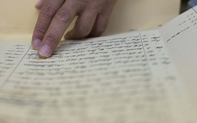 Workers present old documents at the Israeli state archives in Jerusalem on September 3, 2012 (illustrative photo: Yonatan Sindel/Flash90 )