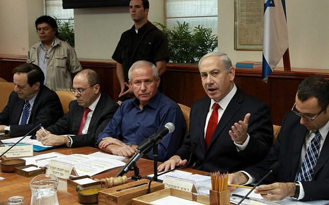 Benjamin Netanyahu (right) at a weekly cabinet meeting in Jerusalem (photo credit: Marc Israel Sellem/Flash90)