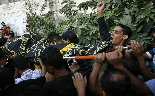 Palestinians carry the body of Abdullah Maqawi during his funeral in the town of Rafah in southern Gaza Strip on Monday. (photo credit: Abed Rahim Khatib / Flash 90)