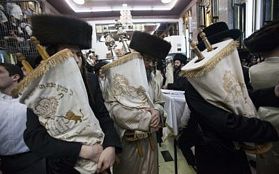 Ultra-Orthodox Jewish men carry Torah scrolls as they dance during Simchat Torah celebrations in Jerusalem's Mea Shearim neighbourhood October 8 (photo credit: Yonatan Sindel/Flash90)