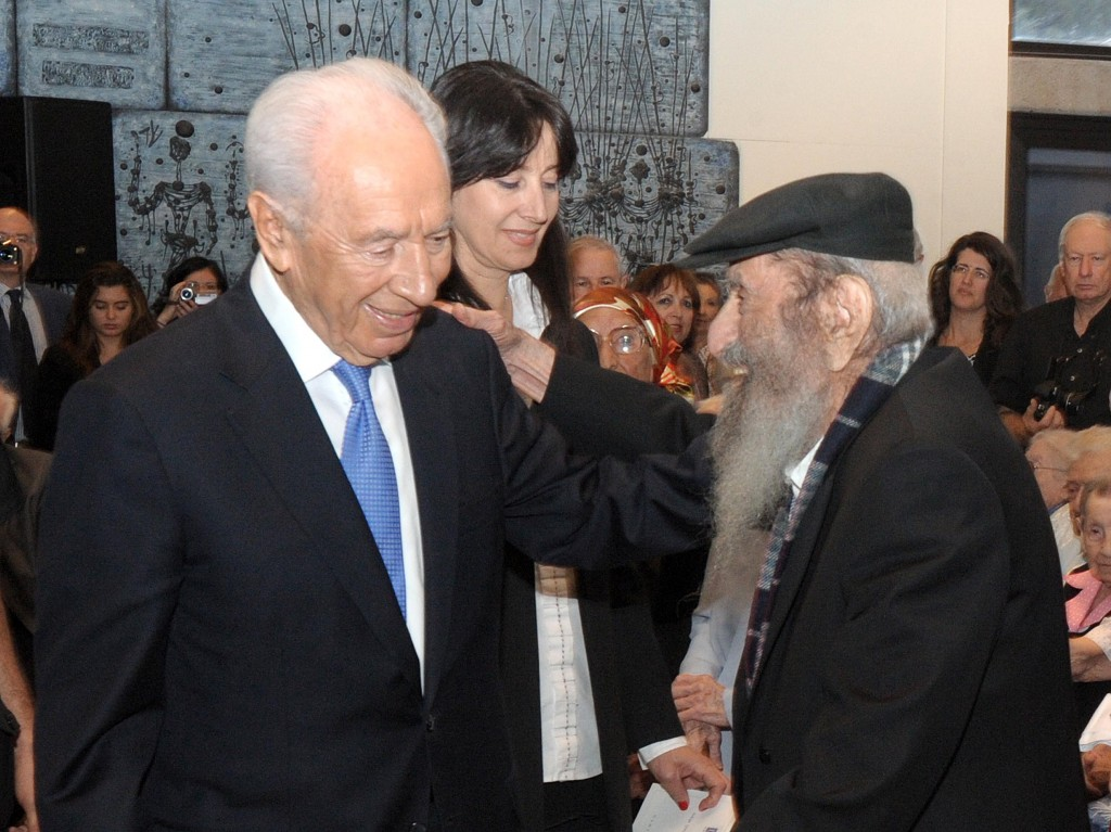 Israel's Number 1 citizen, President Shimon Peres, welcomes the country's oldest citizen, Zechariah Barashi, in Jerusalem, in 2012 (photo credit: Mark Neyman/GPO/Flash90)