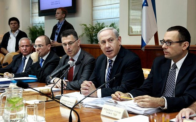 Israeli Prime Minister Benjamin Netanyahu (send from right) addresses the weekly cabinet meeting on Sunday. (photo credit: Marc Israel Sellem/Flash90).