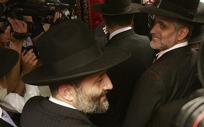 Eli Yishai, right, and Aryeh Deri participate in a circumcision ceremony for the great-grandson of Shas' spiritual leader, Rabbi Ovadia Yosef, on October 14, 2012. (photo credit: Oren Nahshon/Flash90)
