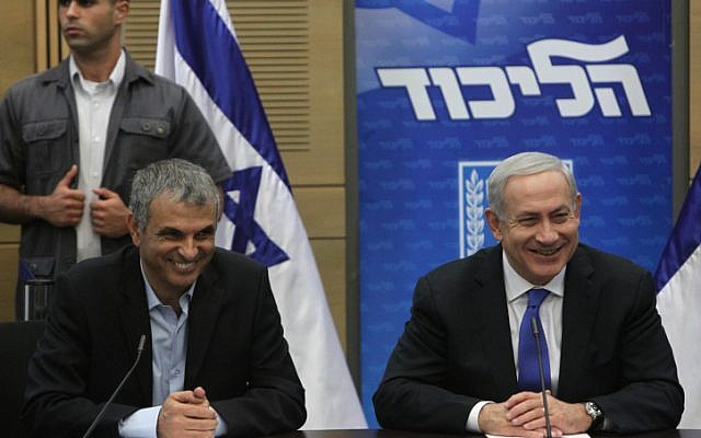 Prime Minister Benjamin Netanyahu (right) and Communications Minister Moshe Kahlon during a Likud committee meeting on Monday. (photo credit: Miriam Alster/Flash90)
