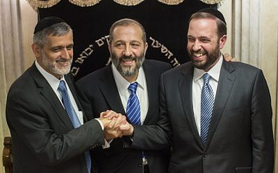 File: Left to right: Interior Minister Eli Yishai , former Shas party chairman Aryeh Deri, and Housing Minister Ariel Atias talk to the press Oct. 17,  2012, after announcing a power-sharing deal for the leadership of the religious Shas Party (photo credit: Yonatan Sindel/Flash90)
