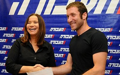 National Student Union chairman Itzik Shmuli, right, one of the leaders of the summer 2011 social justice protests, shakes hands with Shelly Yachimovich as he joins the Labor Party on October 17, 2012. (photo credit: Yossi Zeliger/Flash90)
