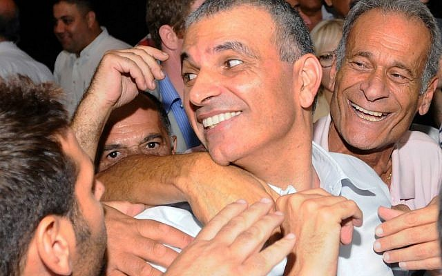 Then-minister of communications Moshe Kahlon is embraced and congratulated by Likud members at a party convention held in Tel Aviv on October 17, 2012. (photo credit: Yossi Zeliger/Flash90)