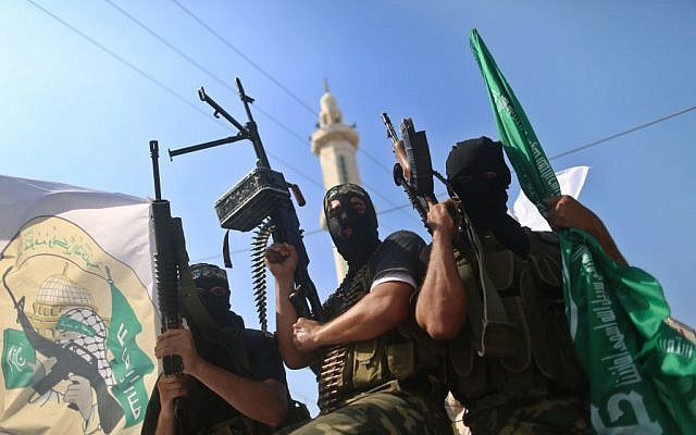 Hamas militants take part in a march in the streets of Gaza City to mark the first anniversary of the Shalit deal.  October 18, 2012 (photo credit: Wissam Nassar/Flash90)