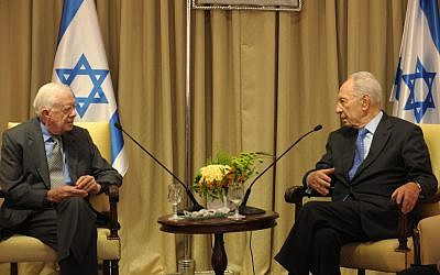 Jimmy Carter meeting with Shimon Peres on Sunday. (photo credit: Mark Neyman/GPO/Flash 90)