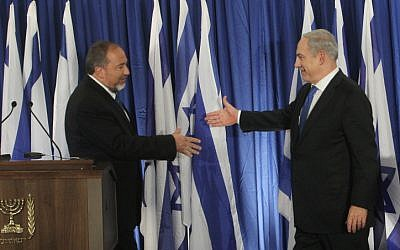 Prime Minister Benjamin Netanyahu (right) and Foreign Minister Avigdor Liberman announce the formation of a united Likud and Yisrael Beytenu list for the upcoming elections, October 2012. (photo credit: Miriam Alster/Flash90)