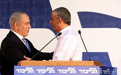 Prime Minister Benjamin Netanyahu embraces outgoing Minister Moshe Kahlon at the Likud Central Committee meeting in Tel Aviv on Monday (photo credit: Roni Schutzer/FLASH90)