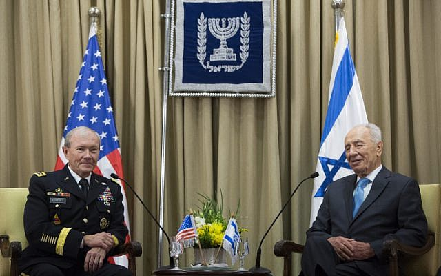 President Shimon Peres (right) talks with US military chief Martin Dempsey during their meeting at the presidential compound in Jerusalem on Monday. (photo credit: Yonatan Sindel/Flash90)