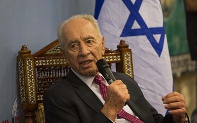 President Shimon Peres speaks during a conference at the Mount Zion hotel in Jerusalem, October 30 (photo credit: Yonatan Sindel/Flash90)