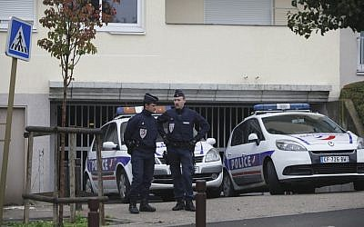 Riot police officers guard a parking lot in Torcy, east of Paris Wednesday, Oct.10, 2012 where police found bomb-making material after police broke up a suspected terrorist cell last week (photo credit: AP/Thibault Camus)