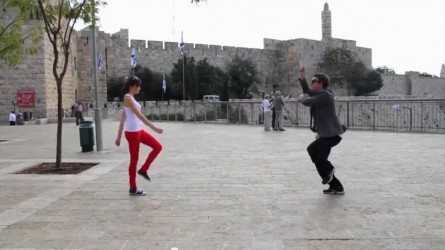 Josef Condiotti and Chen Perez dance outside the Old City walls (screen capture/YouTube)