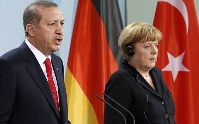 Germany Chancellor Angela Merkel and Turkey's Prime Minister Recep Tayyip Erdogan address the media during a joint press conference after a meeting at the chancellery in Berlin, Germany, in October 2012 (photo credit: AP/Michael Sohn)