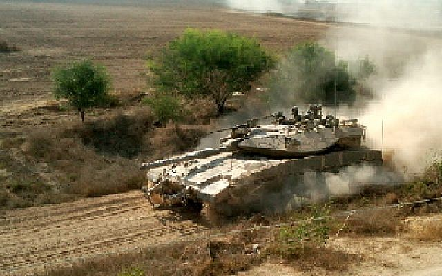 An IDF tank patrolling along the border of the Gaza Strip in 2011. (photo credit: Ilan Ben Zion/Times of Israel staff)