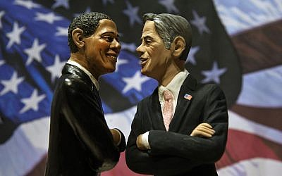 Two statuettes depicting President Barack Obama, left, and Republican rival Mitt Romney are backdropped by the Stars and Stripes in a shop which sells Christmas nativity figures in Naples, Italy, Monday, Oct. 22, 2012, hours ahead of their third and final presidential debate in Boca Raton, Florida. (photo credit: Salvatore Laporta/AP)